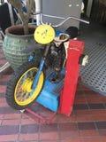 Χρησιμοποιημένο νόμισμα ποδήλατο για τα παιδιά Στοκ Φωτογραφία
