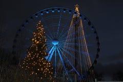 Χριστουγεννιάτικα δέντρα και μια ρόδα ferris Στοκ Εικόνες