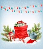 Χριστουγεννιάτικα δώρα με μια γιρλάντα και ένα σύνολο σάκων των κιβωτίων δώρων Στοκ εικόνες με δικαίωμα ελεύθερης χρήσης