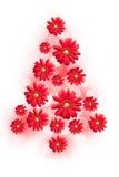 Χριστουγεννιάτικο δέντρο με τα κόκκινα λουλούδια μαργαριτών στοκ φωτογραφία με δικαίωμα ελεύθερης χρήσης