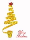 Χριστουγεννιάτικο δέντρο που γίνεται από την ταινία μέτρου Στοκ Εικόνα