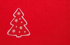 Χριστουγεννιάτικο δέντρο στο κόκκινο Στοκ Εικόνα