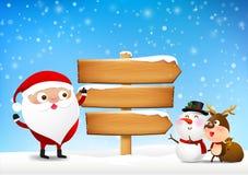 Χριστούγεννα Άγιος Βασίλης και ξύλινοι κενοί πίνακας σημαδιών και χειμερινό χιόνι Στοκ Φωτογραφία