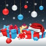 Χριστούγεννα ή νέα κάρτα έτους με τα δώρα στο χιόνι ελεύθερη απεικόνιση δικαιώματος