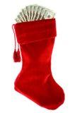Χριστούγεννα: Γυναικεία κάλτσα Χριστουγέννων με τα χρήματα Στοκ Εικόνες