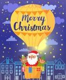 Χριστούγεννα εύθυμα Άγιος Βασίλης, ελάφια και νεράιδα στο μπαλόνι ζεστού αέρα Στοκ Φωτογραφίες