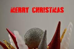 Χριστούγεννα εύθυμα Ζωηρόχρωμες διακοσμήσεις Η Χαρούμενα Χριστούγεννα επιγραφής Στοκ Εικόνες