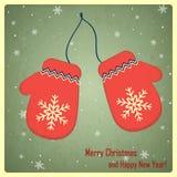 Χριστούγεννα και νέα ευχετήρια κάρτα έτους με τα γάντια Στοκ Εικόνες