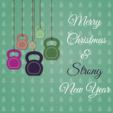 Χριστούγεννα και νέα ευχετήρια κάρτα έτους με τα kettlebells Στοκ Φωτογραφίες