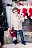 Χριστούγεννα και νέο αγόρι έτους Στοκ Φωτογραφία