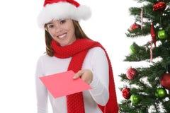 Χριστούγεννα καρτών που δίνουν τη γυναίκα Στοκ Εικόνες