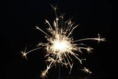 Χριστούγεννα καψίματος sparkler Στοκ Φωτογραφίες