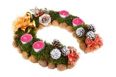 Χριστούγεννα κεριών στεφανιών εμφάνισης Στοκ εικόνες με δικαίωμα ελεύθερης χρήσης