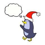 Χριστούγεννα κινούμενων σχεδίων penguin με τη σκεπτόμενη φυσαλίδα Στοκ εικόνα με δικαίωμα ελεύθερης χρήσης
