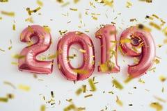 Χριστούγεννα κομφετί μπαλονιών 2019 και νέος εορτασμός έτους στοκ φωτογραφίες