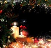 Χριστούγεννα. Τρία κεριά και μπλε ερυθρελάτες Στοκ Εικόνες