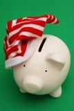 Χριστούγεννα τραπεζών piggy Στοκ φωτογραφία με δικαίωμα ελεύθερης χρήσης