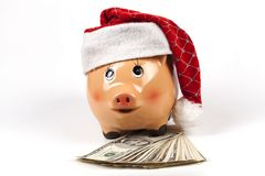 Χριστούγεννα Piggy στα δολάρια Στοκ φωτογραφία με δικαίωμα ελεύθερης χρήσης