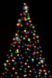 Χριστούγεννο-δέντρο με τα φω'τα ελεύθερη απεικόνιση δικαιώματος
