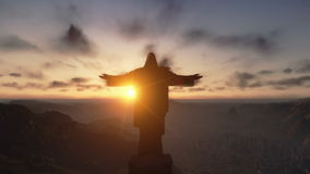 Χριστός το Redemeer στο ηλιοβασίλεμα, Ρίο ντε Τζανέιρο, κλείνει επάνω, γέρνει, μήκος σε πόδηα αποθεμάτων φιλμ μικρού μήκους