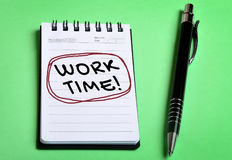 Χρονική λέξη εργασίας στο σημειωματάριο Στοκ φωτογραφία με δικαίωμα ελεύθερης χρήσης