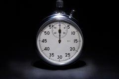 Χρονόμετρο με διακόπτη στο μαύρο υπόβαθρο Στοκ Εικόνες