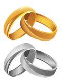 Χρυσά & ασημένια γαμήλια δαχτυλίδια απεικόνιση αποθεμάτων