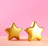 χρυσά αστέρια καρτών Χριστ&omic Στοκ Εικόνα