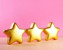 χρυσά αστέρια καρτών Χριστ&omic Στοκ φωτογραφία με δικαίωμα ελεύθερης χρήσης
