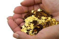 χρυσά αστέρια χουφτών Στοκ εικόνες με δικαίωμα ελεύθερης χρήσης