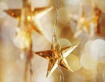 Χρυσά αστέρια Χριστουγέννων Στοκ Εικόνα