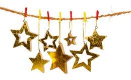 χρυσά αστέρια Χριστουγένν& Στοκ Φωτογραφίες