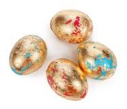 Χρυσά αυγά στο άσπρο υπόβαθρο Στοκ εικόνες με δικαίωμα ελεύθερης χρήσης