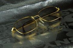 Χρυσά γυαλιά πλαισίων Στοκ εικόνες με δικαίωμα ελεύθερης χρήσης