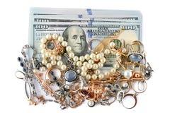 Χρυσά διακοσμήσεις και δολάρια που απομονώνονται στο άσπρο υπόβαθρο Στοκ Εικόνα
