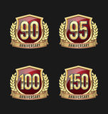 Χρυσά και κόκκινα 90α, 95α, 100α, 150α έτη διακριτικών επετείου Στοκ Φωτογραφία
