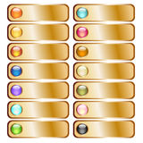 Χρυσά κουμπιά με τις ζωηρόχρωμες στιλπνές σφαίρες Στοκ φωτογραφία με δικαίωμα ελεύθερης χρήσης