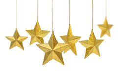 χρυσά κρεμώντας αστέρια Στοκ Εικόνες