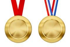 Χρυσά μετάλλια που τίθενται με τις διαφορετικές κορδέλλες Στοκ Εικόνες
