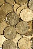 Χρυσά νομίσματα δύο δολαρίων διεσπαρμένα Στοκ Εικόνα