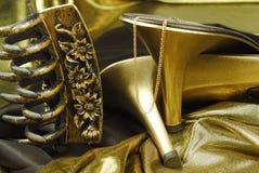 χρυσά παπούτσια womans Στοκ Εικόνες