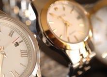 χρυσά ρολόγια Στοκ Εικόνες