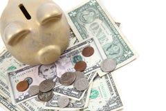 Χρυσά τράπεζα και δολάρια χοίρων Στοκ εικόνα με δικαίωμα ελεύθερης χρήσης