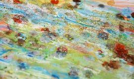 Χρυσά φω'τα σπινθηρίσματος Watercolor, πορτοκαλί πράσινο ρόδινο αφηρημένο υπόβαθρο κρητιδογραφιών Στοκ φωτογραφία με δικαίωμα ελεύθερης χρήσης