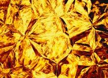 Χρυσά χρωματισμένα υπόβαθρα πυρκαγιάς κρυστάλλου ανακούφισης Στοκ Εικόνες