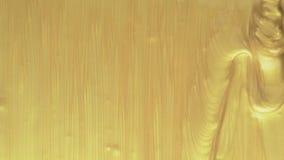 Χρυσές ακρυλικές ροές χρωμάτων φιλμ μικρού μήκους