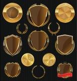 Χρυσές ασπίδες, ετικέτες και laurels, χρυσή και καφετιά συλλογή Στοκ Εικόνα
