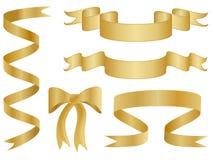 χρυσές κορδέλλες τόξων Στοκ Εικόνες
