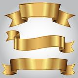 Χρυσές ρεαλιστικές κορδέλλες πολυτέλειας καθορισμένες απεικόνιση αποθεμάτων