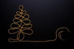 Χρυσές χάντρες χριστουγεννιάτικων δέντρων Στοκ Φωτογραφίες